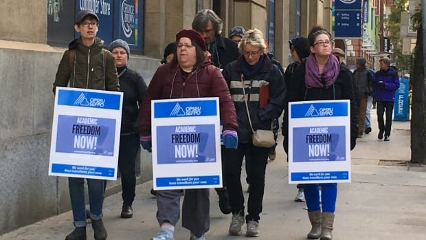 Faculty walk the picket line at George Brown College in Toronto on Monday, the first day of a strike by colleges in Ontario.