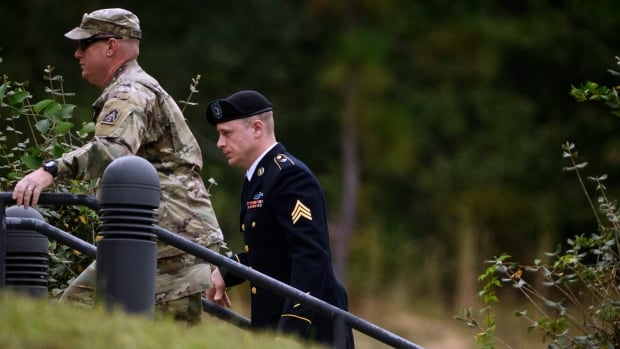 Sgt. Bowe Bergdahl, right, arrives for a hearing on Monday at Fort Bragg, N.C.  Bergdahl, who walked off his base in Afghanistan in 2009 and was held by the Taliban for five years, could face years behind bars.
