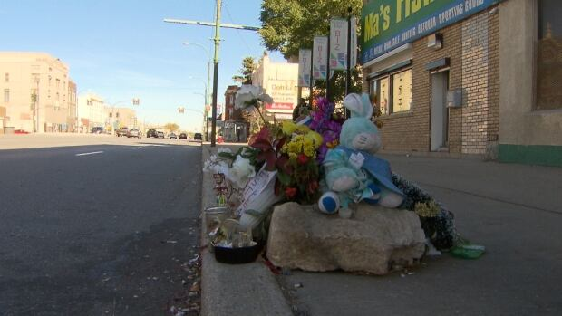 Flowers sit on the curb next to Main Street close to where Cody Severight, 23, died last Tuesday.