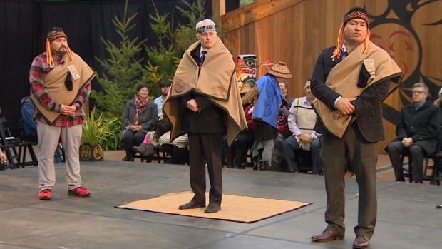 Simon Fraser University President Andrew Petter takes part in a Coast Salish witnessing ceremony. (Don Marce)