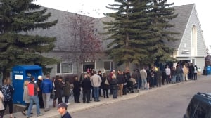Long waits, ballot shortage mar election night as Calgarians turn out in droves to vote