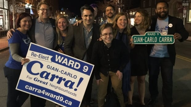 Gian-Carlo Carra, second from the left, takes a victory photo with campaign team members in Calgary's Inglewood community.