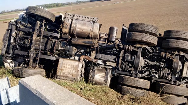 A Windsor man has been charged with careless driving Tuesday after losing control of a tractor trailer on Highway 401, smashing through a guardrail and rolling the truck.