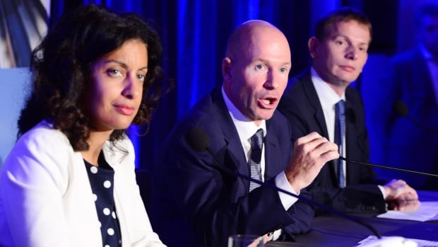 Quebec Economy, Science and Innovation Minister Dominique Anglade, left to right, Bombardier president and CEO Alain Bellemare and CEO of North America for Airbus Helicopters Romain Trapp speak to the media following Monday's announcement.