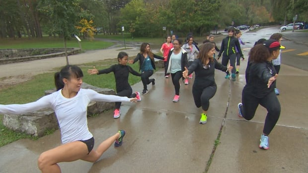 Rain or shine, Parkdale Roadrunner Nina Sieh leads this group of young women through their training for the Scotiabank Waterfront Marathon.