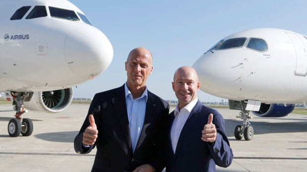Tom Enders, CEO of Airbus, and Alain Bellemare, CEO of Bombardier, pose Tuesday in France. Bombardier's plan to donate a majority stake in its CSeries plane (right)  to Airbus may be the Canadian company's shrewdest investment.