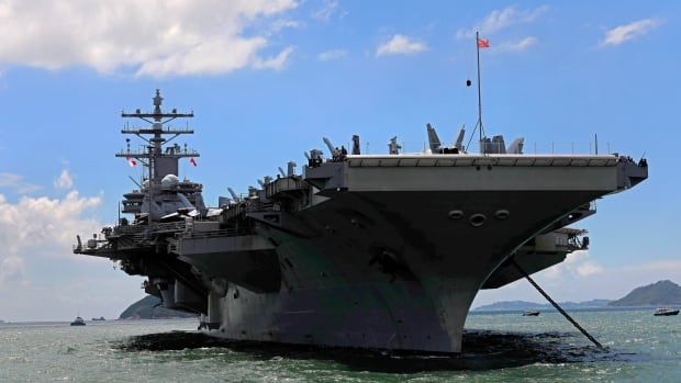 In this Oct. 2 file photo, the USS Ronald Reagan aircraft carrier arrives in Hong Kong. The U.S. navy says an aircraft carrying 11 passengers and crew crashed into the Pacific Ocean en route to the aircraft carrier.