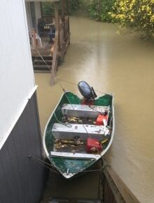 Boat tied to house