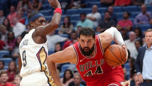 Nikola Mirotic, right, suffered multiple broken bones in his face as well as a concussion in a fight with teammate Bobby Portis during practice.