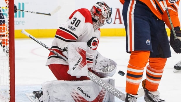 Cam Ward, left, made 48 saves as the Carolina Hurricanes defeated the Edmonton Oilers 5-3 on Tuesday evening.