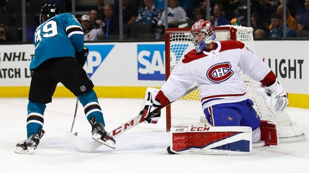 Logan Couture, left, scored twice in the San Jose Sharks' 5-2 victory over the Montreal Canadiens on Tuesday evening.