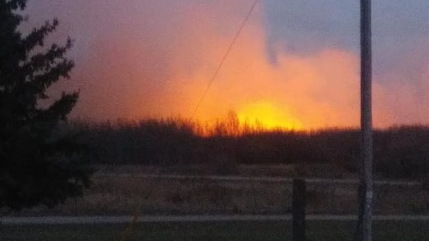 A fire near Red Pheasant First Nation, Sask., burns on Tuesday evening.