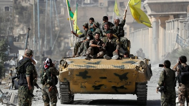 Fighters with the Syrian Democratic Forces celebrated their victory over ISIS in Raqqa, which the militants had declared as their capital in 2014.