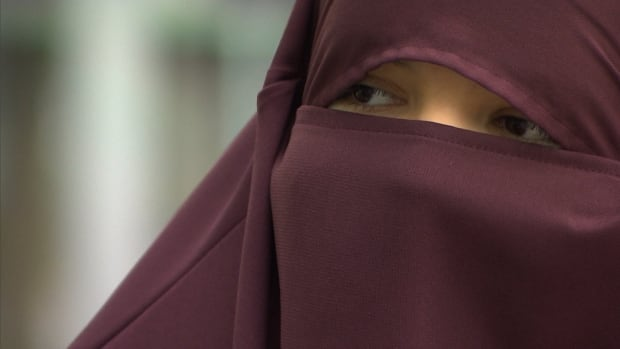 Quebec's new law against face-coverings, passed on Oct. 17, is prompting a lot of questions. It would ban people like Zayneb Binruchd from receiving public services while wearing face-coverings such as her niqab.