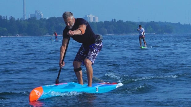 Larry Cain won Olympic gold and silver medals in sprint canoe in Los Angeles in 1984, but in recent years has become a devoted convert to stand-up paddleboarding. He's seen here paddling his SUP on Lake Ontario near Oakville, where he trains regularly.