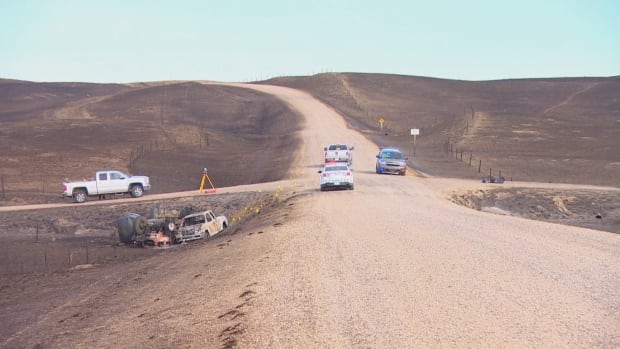A 34-year-old volunteer firefighter died while driving a water-tanker truck on this grid road south of Burstall, Sask., late Tuesday night or early Wednesday morning. A white pickup truck, also seen in this photo, later collided with the water tanker.
