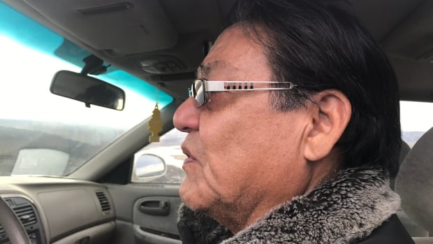 A tear runs down Norbert Bear Chief's cheek as he looks at what's left of his home on the Siksika Nation after it was destroyed by fire Tuesday night.