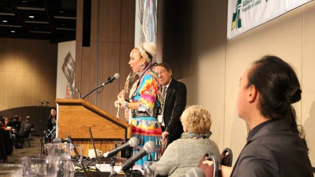 This year's annual convention featured a jingle dress demonstration by Saskatoon resident Randi Lynn Nanemahoo-Candline, who is a member of Big Stone Cree Nation in Alberta. Here, she explains the jingle dress to hundreds of Saskatchewan Federation of Labour convention attendees.