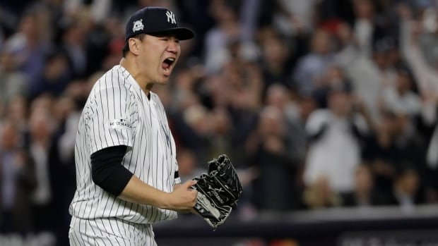 New York starting pitcher Masahiro Tanaka reacts after striking out Houston's Josh Reddick during the Yankees' 5-0 win in Game 5 of the ALCS on Wednesday.