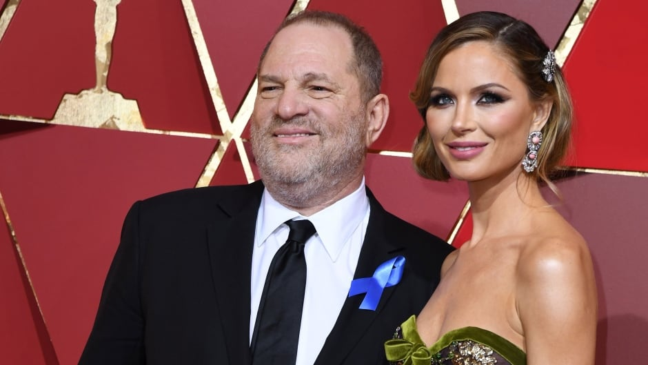 Film producer Harvey Weinstein and his wife, designer Georgina Chapman, pose as they arrive on the red carpet for the 89th Oscars on February 26, 2017.