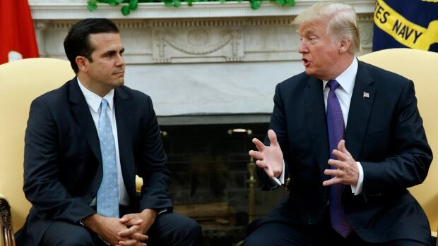 U.S. President Donald Trump meets with Gov. Ricardo Rossello of Puerto Rico in the Oval Office of the White House on Thursday in Washington.
