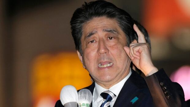 Japanese Prime Minister Shinzo Abe campaigns in Tokyo Wednesday for the lower house election scheduled for Sunday.