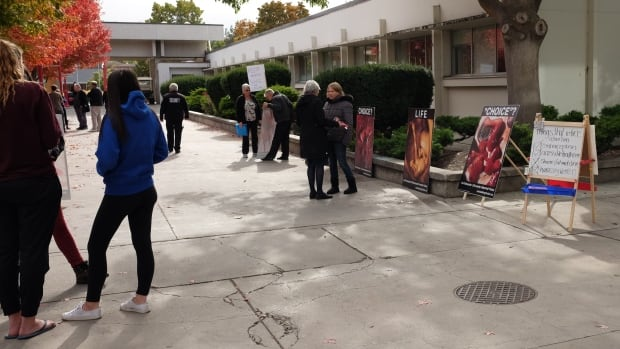 Demonstrators gathered outside the Okanagan College Kelowna campus with large, graphic photos of aborted fetuses.