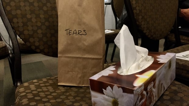People are asked to put their tear-soaked tissues in these bags so they can be burned in the sacred fire during the closing ceremony.