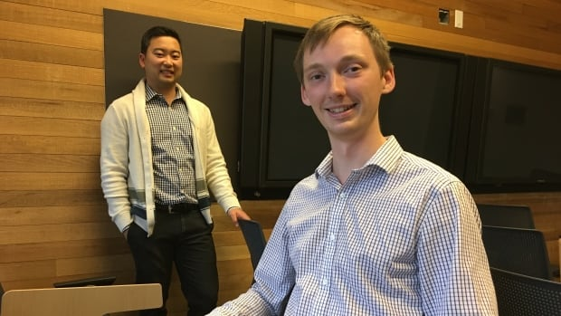 Jason Min (left), a lecturer in UBC's faculty of pharmaceutical sciences, with first-year medical student Dakota Peacock.