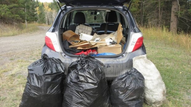 Wilber Saunders walks multiple kilometres every day collecting garbage which he then loads into his car to take to the dump.