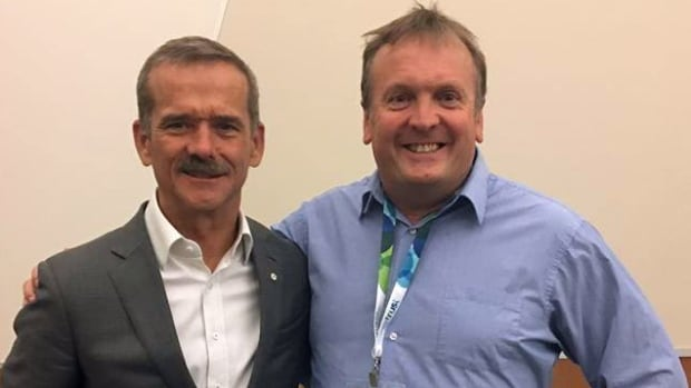 Lloyd Smith, right, seen here with astronaut Chris Hadfield, has been identified as one of the victims of a deadly ammonia leak at an arena in Fernie, B.C. Smith met Hadfield at a recent conference where the astronaut was a speaker.