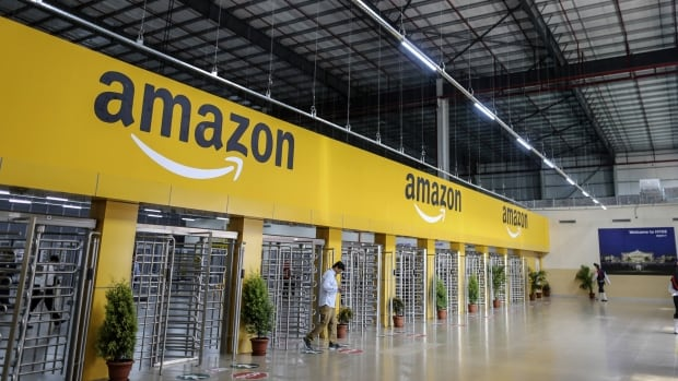 An employee exits the warehouse floor of the Amazon.com warehouse in Hyderabad, India. The company is looking for a new second headquarters, and many Canadian cities have thrown their hats into the ring.