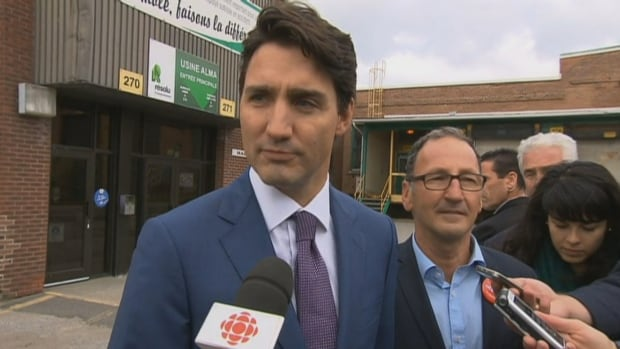 While out campaigning in Alma, Que., with Richard Hébert, Prime Minister Justin Trudeau says the federal government is looking into the implications of Quebec's Bill 62.