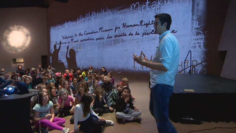 Author David A. Robertson speaking to Ecole Laura Secord School students at the Canadian Museum for Human Rights in Winnipeg.