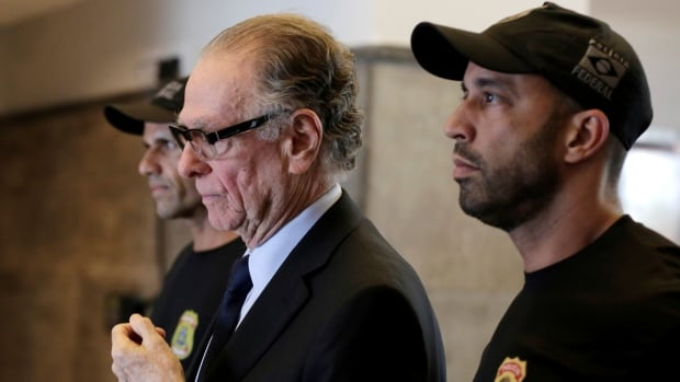 Carlos Nuzman, centre, could face a prolonged corruption trial in Brazil's slow-moving justice system.