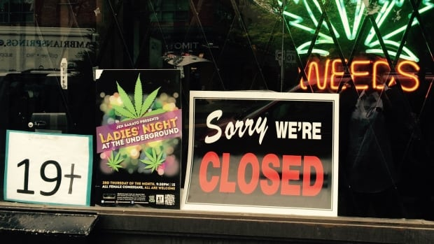 Marijuana dispensaries like this one in Toronto are regularly being raided by police, but it's still not clear exactly what day the new legal recreational marijuana regime will actually take effect.