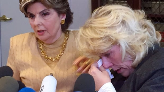 Heather Kerr, right, a former actress who alleges that entertainment mogul Harvey Weinstein exposed himself to her in 1979, wipes her eye as her attorney Gloria Allred speaks at a news conference in Los Angeles Friday.