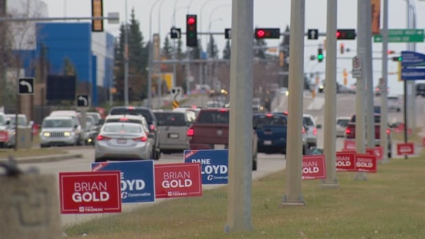 Campaign signs for Conservative candidate Dane Lloyd and Liberal candidate Brian Gold dotted the side of a road in Spruce Grove. Voters in Sturgeon River-Parkland are electing a new MP Monday in the seat formerly held by Rona Ambrose. Ambrose retired from federal politics in June.