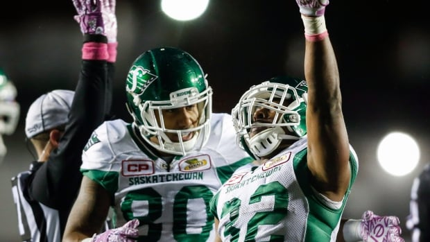 Cameron Marshall, right, of the Roughriders celebrates a touchdown with teammate Spencer Moore during Saskatchewan's 30-7 win over the Calgary Stampeders on Friday.