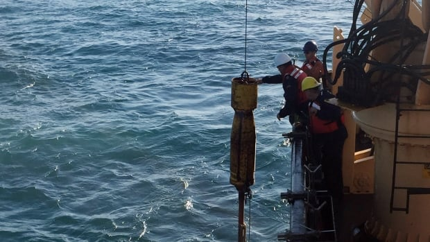 Scientists prepare to lower a piston corer off Haida Gwaii, B.C., to sample seafloor sediment near the Queen Charlotte-Fairweather fault.