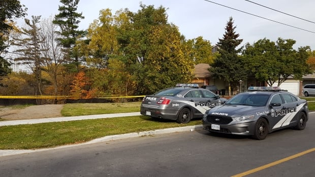 Police investigate after a body was found in a ravine off Derrydown Road Saturday morning
