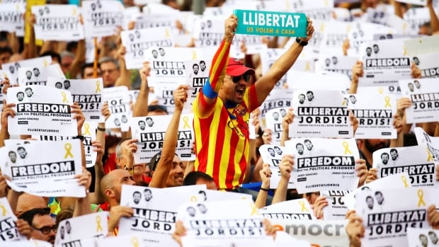 Protesters in Barcelona wave placards Saturday that read 'Freedom for the Jordis' and 'We want them home' during a demonstration organized by Catalan pro-independence groups following the imprisonment of leaders Jordi Sanchez and Jordi Cuixart.