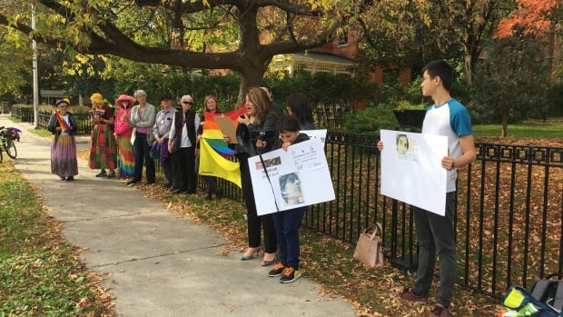 Protesters stand outside the Embassy of the Arab Republic of Egypt in Ottawa.  They want the Canadian government to address the detainment of dozens of Egyptians because of their sexual orientation.