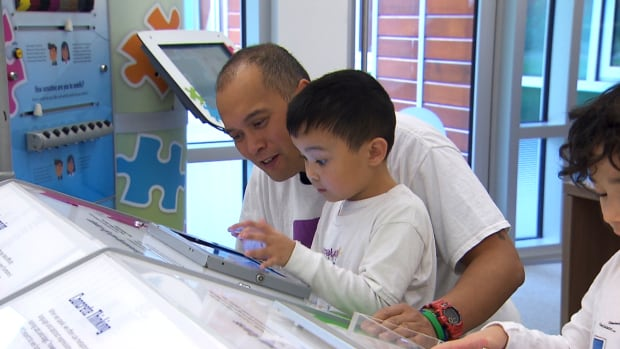 A technology hub provides iPads and autism-specific games for library patrons.