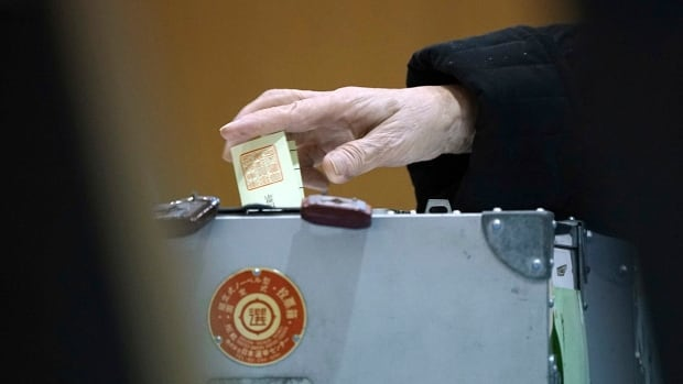 A voter casts a ballot at a polling station in Tokyo on Sunday.