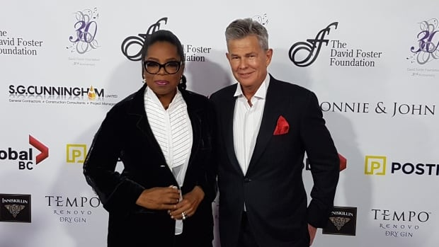 Oprah Winfrey, poses with David Foster, after arriving to the David Foster Foundation's 30th annual Miracle Concert in Vancouver.