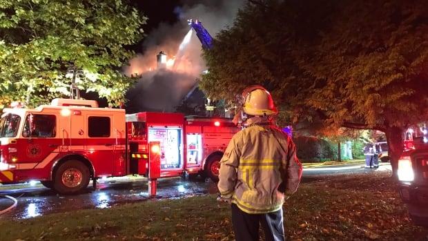 Deputy Chief Brian Godlonton looks on as crews fight a three-alarm blaze in Shaughnessy.