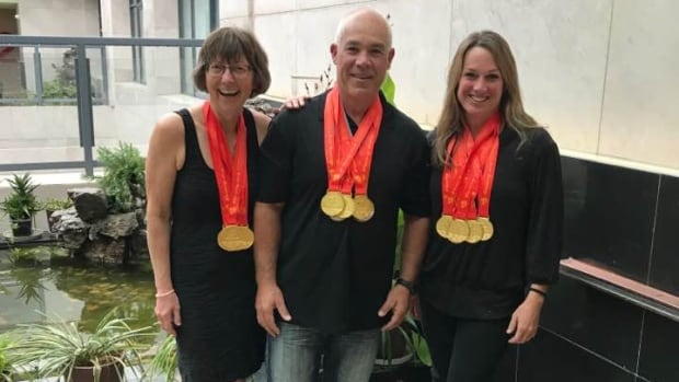 Deborah Woolway (left), David Gallant and Jan Houseman with gold medals they won at the Dragon Boat World Championships.