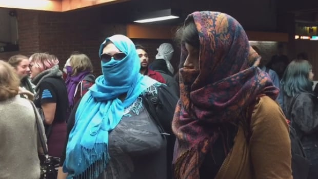 Protesters entered Snowdon Metro with their faces covered Sunday to demonstrate against Bill 62.