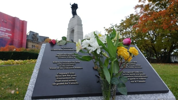 Flowers rest on the plaque honouring Cpl. Nathan Cirillo on Sunday. Prime Minister Justin Trudeau issued a statement on the third anniversary of the attack calling on Canadians to honour the bravery of first responders during the shooting.